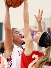 Cobre players dominated play in the paint during Saturday's 49-36 win at Deming High School.