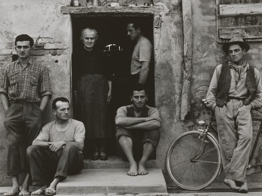 The Family, Luzzara (The Lusettis), 1953 (negative); mid- late 1960s (print). Paul Strand, American, 1890 - 1976. Gelatin silver print, Image: 11 7/16 x 14 9/16 inches (29.1 x 37 cm) Sheet (irregular): 11 3/4 x 15 1/16 inches (29.8 x 38.3 cm). The Paul Strand Collection, purchased with funds contributed by Lois G. Brodsky and Julian A. Brodsky, 2014. ? Paul Strand Archive/Aperture Foundation