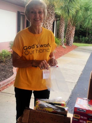 Marilou Holmes fills one of the toiletry bags donated by Christ the King Lutheran, Sebastian, to the Veterans Council of Indian River County.