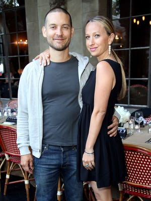 Actor Tobey Maguire (L) and wife Jennifer Meyer attend Jennifer Meyer for the Zoe Report Dinner at Chateau Marmont on June 18, 2014 in Los Angeles, California.