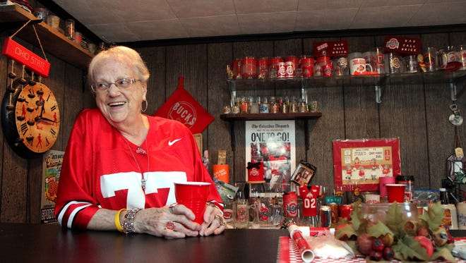 Starley Smith, 79, of Zanesville, relaxes behind her basement bar Tuesday surrounded by Ohio State University memorabilia she has collected over the years. Smith started collecting in 1953, but her memorabilia dates back to the 1930s after inheriting her brother Don McKeown,s collection. McKeown played one year for OSU in 1935.