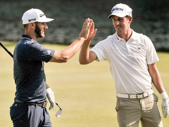 June 9, 2018 - Dustin Johnson, left, greets Andrew Putnam after Johnson sank a shot from the fairway of the 18th green to during the final round of the FedEx St. Jude Classic at TPC Southwind to become the tournament's winner. (Brandon Dill/Special to The Commercial Appeal)