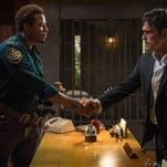 """In this image released by Fox, Matt Dillon, portraying Ethan Burke, right, appears with Terrence Howard, portraying Sheriff Arnold Pope in a scene from the series """"Wayward Pines,"""" premiering May 14. (AP Photo/Fox, Ed Araquel)"""