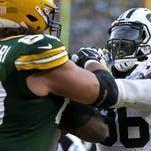 Green Bay Packers tackle David Bakhtiari (69) gets into a scuffle with New York Jets defensive lineman Muhammad Wilkerson (96) in the third quarter during Sunday's game at Lambeau Field. Wilkerson was ejected from the game.