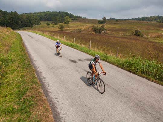 Cyclists make their way toward Greenville during the