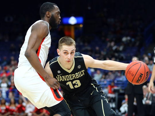 Vanderbilt Commodores guard Riley LaChance (13) handles