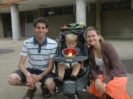 Nate and Jessica Butler pose with their son, Max.