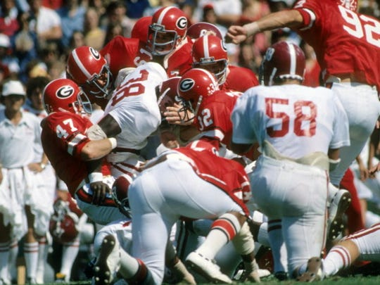 College Football: Alabama Johnny Davis (38) in action, rushing vs Georgia defense at Sanford Stadium.  Athens, GA 10/2/1976