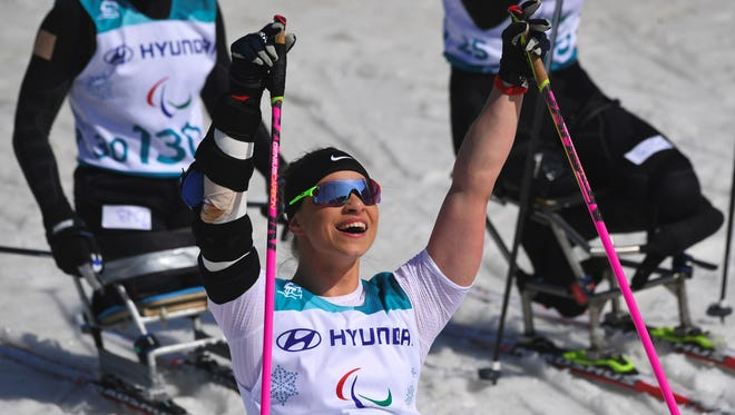 Oksana Masters of the U.S. celebrates her victory after crossing the finish line in the women's 1.1-kilometer sprint sitting cross-country skiing final event of the Pyeongchang Winter Paralympic Games at the Alpensia Biathlon Centre on March 14.