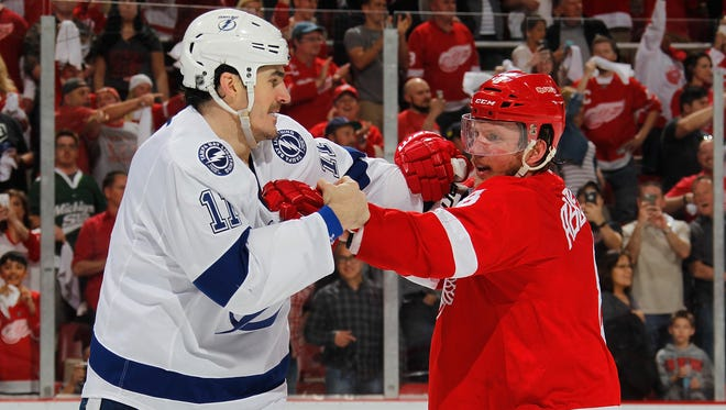 The Lightning's Brian Boyle looks for a fight with Red Wings forward Justin Abdelkader after the end of the Wings' 2-0 win in Game 3 of the Eastern Conference quarterfinals Sunday at Joe Louis Arena.