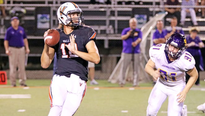 Valley junior quarterback Beau Lombardi (12) rolls out of the pocket to throw deep as the then-No. 3 Johnston Dragons battle the No. 4 Valley Tigers in the first half of play during the Class 4A Homecoming game at Valley Stadium.