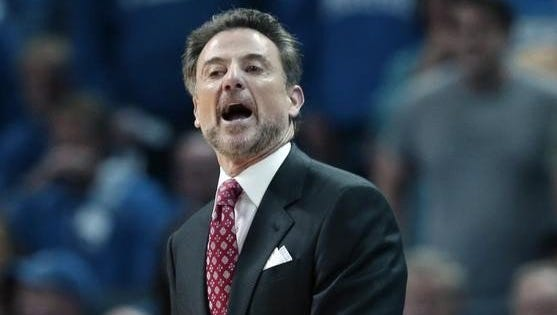 Louisville coach Rick Pitino shouts in the first half of an NCAA college basketball game against Memphis in Memphis, Tenn.