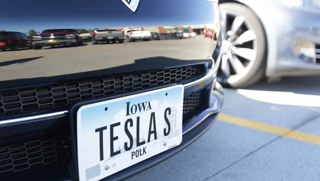 A Tesla electric car sits on display on Saturday at the Hy-Vee on Douglas Avenue in Urbandale.