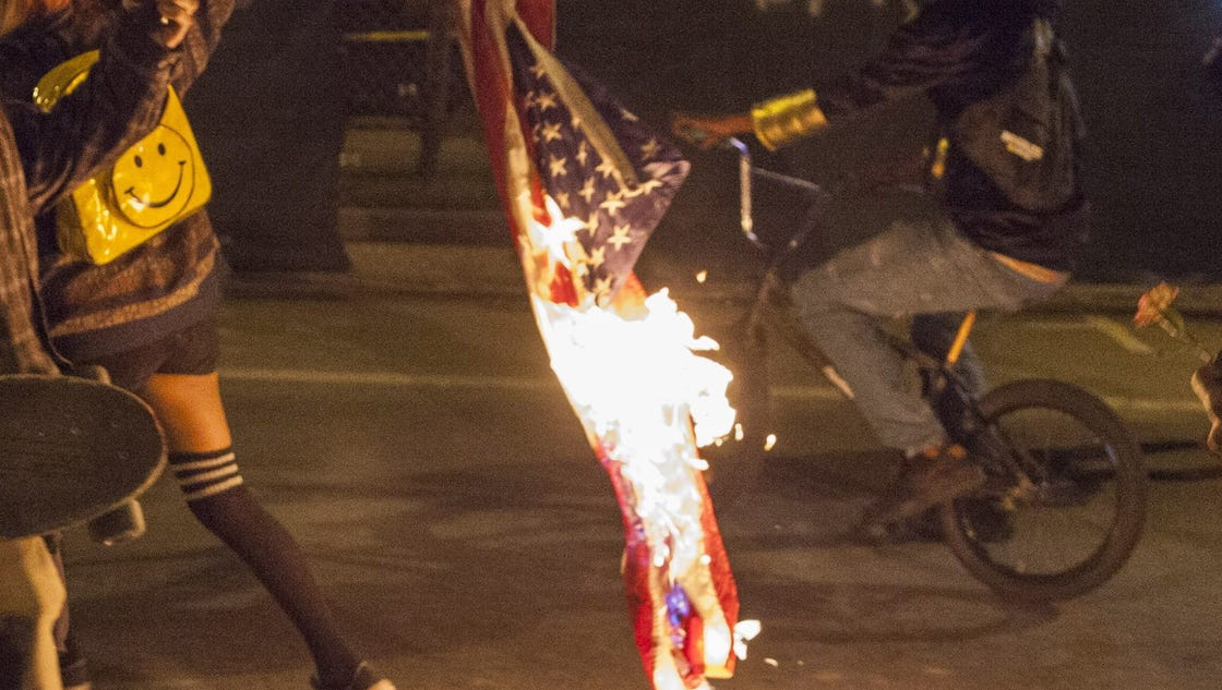 """the burning of the american flag by prostesters Carl dix of the revolutionary communist party said the group organized the burning of the american flag as a """"political statement about the."""