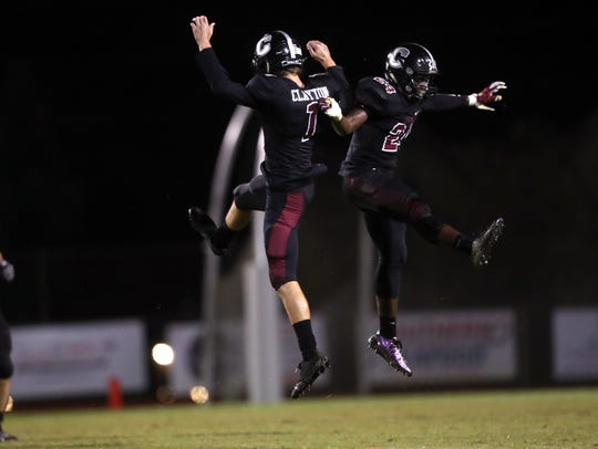 Chiles' Nicholas Clayton, left, and Devin Harrell celebrate