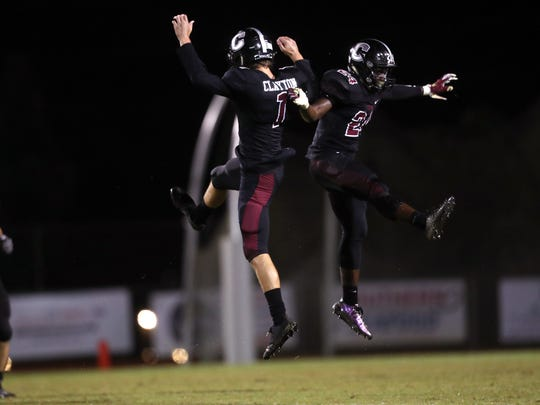 Chiles' Nicholas Clayton, left, and Devin Harrell celebrate during their game against Wakulla at Chiles High School on Thursday, Aug. 31, 2017.