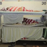 Inmates sleep three to a bunk in Block C in August 2012 at the Monterey County Jail.