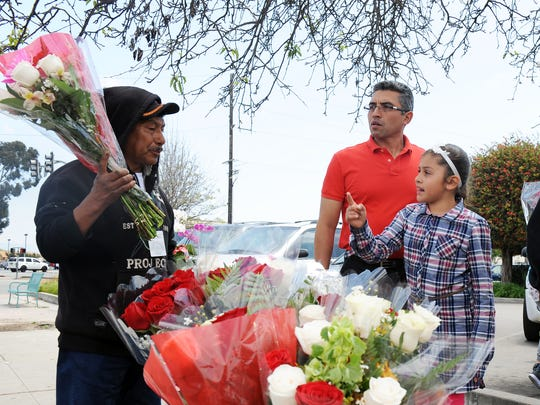 Lizbeth Sandoval, 8, knows which bouquet she wants to give her mom on Sunday for Mother's Day in Salinas. Flower vendors throughout the city worked double-time to make the day a success.