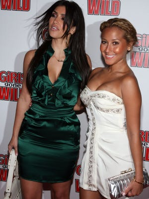 Kim Kardashian and Adrienne Bailon arrive at the Girls Gone Wild Magazine Launch party held at Area Nightclub on April 22, 2008 in West Hollywood, California.  (Photo by Frazer Harrison/Getty Images)