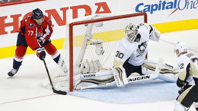 Washington Capitals right wing T.J. Oshie (77) scores the game-winning goal on Pittsburgh Penguins goalie Matt Murray (30) in overtime in game one of the second round of the 2016 Stanley Cup Playoffs at Verizon Center.