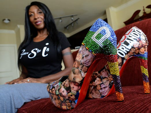Nicole Tackett of Viera holds a pair of shoes she designed