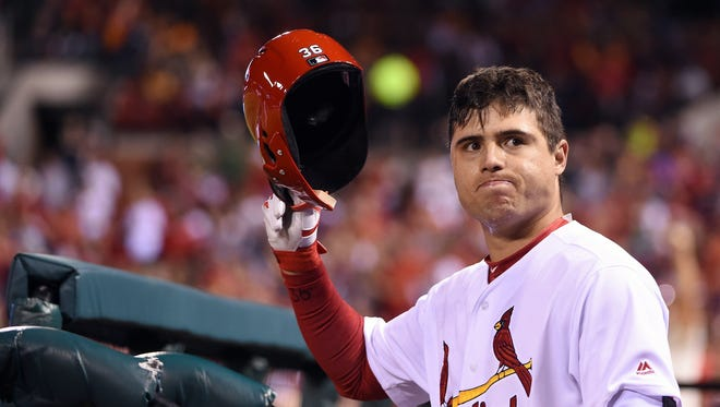 Aledmys Diaz receives a curtain call after hitting a grand slam off of Reds pitcher Robert Stephenson.