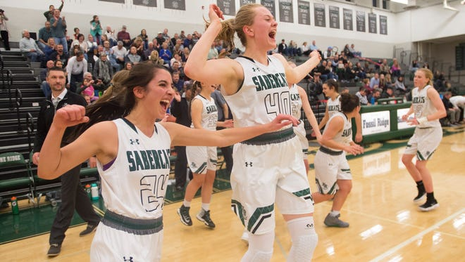 Sophia Hadad and Reilly Dunn of Fossil Ridge celebrate with the SaberCats after a 50-39 win over Mountain Vista in a Sweet 16 playoff game on Tuesday, February 27, 2018.