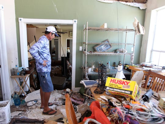 Scott McCune searches for anything salvageable among