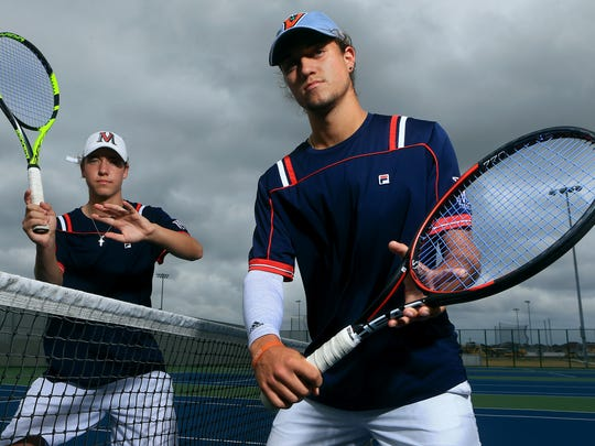 Veterans Memorial's Jason (left) and Michael Loyd pose for a photo Tuesday, May 16, 2017, at Veterans Memorial High School in Corpus Christi. The Loyd brothers will be competing in the state tennis tournament.