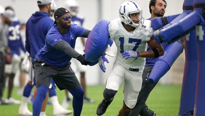 Former Colts wide receiver Reggie Wayne works with wide receiver James Wright (17)  during their sixth day of training camp at Grand Park in Westfield on Wednesday, August 1, 2018.