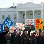 Demonstrators gather in front of the White House on Jan. 10 to encourage President Obama to veto legislation approving the Keystone pipeline.