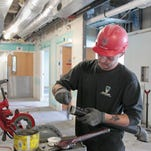 Chris Sturm of Castile, working for Davis-Ulmer of Rochester, threads pipes as he works in the new oncology department that is under construction at Strong West in Brockport on Tuesday. The new department is slated to be finished and open to the public by June this year.