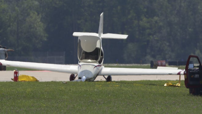 A planes landing gear collapsed upon landing Tuesday, July 24, 2018, on Runway 36L at Wittman Regional Airport in Oshkosh, Wis. The 66th annual Experimental Aircraft Association AirVenture fly-in convention draws over 500,000 people annually to the area. The convention runs through July 29.
