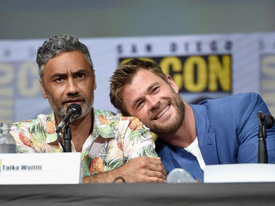 Taika Waititi (L) and actor Chris Hemsworth from Marvel Studios' 'Thor: Raganrok' at the San Diego Comic-Con International 2017 Marvel Studios Panel in Hall H on July 22, 2017 in San Diego.