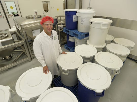Nature's Way production operations supervisor Chris Fredrick poses in the sterile production area at the company's Green Bay plant.