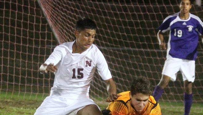 Clarkstown North goalie Jacob Tomanelli scoops up the ball in front of Nyack's Hector Sandoval during their game at Nyack Oct. 14, 2014. Clarkstown North won 2-1.