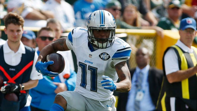 Detroit Lions' Marvin Jones (11) gets past Green Bay Packers' Josh Hawkins (28) for a touchdown catch during the first half of an NFL football game Sunday, Sept. 25, 2016, in Green Bay, Wis.