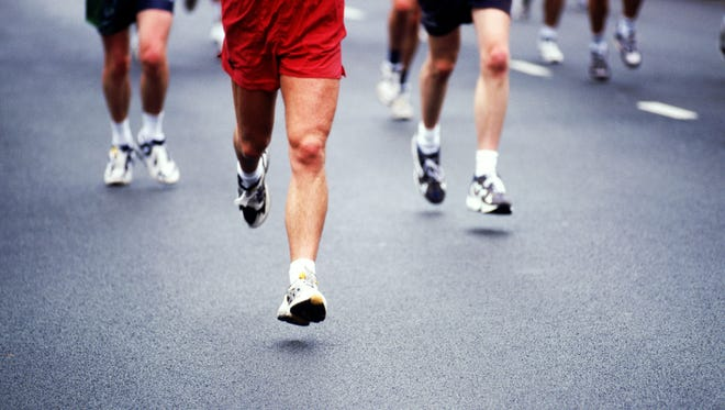 Marathon runners on road