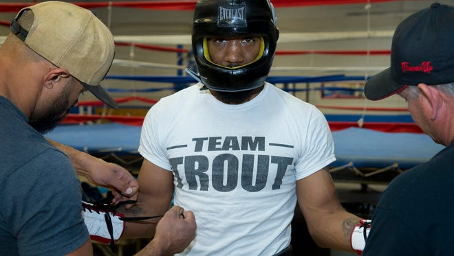 "Austin ""No Doubt"" Trout, a professional boxer, will take on Holy Cross Principal Adrian ""The Boss"" Galaz in a boxing exhibition Oct. 6, 2018, at Oñate High School gymnasium from 1 to 3 p.m."