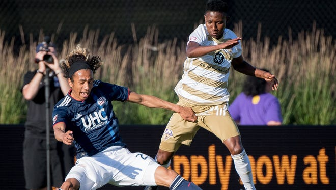 Louisville City FC midfielder Devon Williams (80) collides with New England Revolution defender Andrew Farrell (2) during the game played at Lynn Stadium in Louisville, Ky, June 5, 2018.