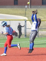 Mountain Home's Sydnie Zimmer catches a fly ball against