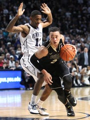 Jan 17, 2015; University Park, PA, USA; Purdue Boilermakers guard Kendall Stephens (21) drives the ball around Penn State Nittany Lions guard Geno Thorpe (13) during the second half at Bryce Jordan Center. Purdue defeated Penn State 84-77 in overtime. Mandatory Credit: Matthew O'Haren-USA TODAY Sports