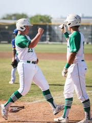 Wall players celebrate at home plate against Reagan