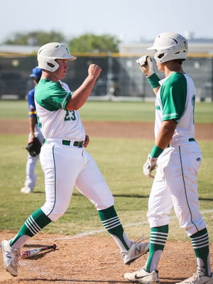 Wall players celebrate at home plate against Reagan County Monday, April 16, 2018, at Wall.