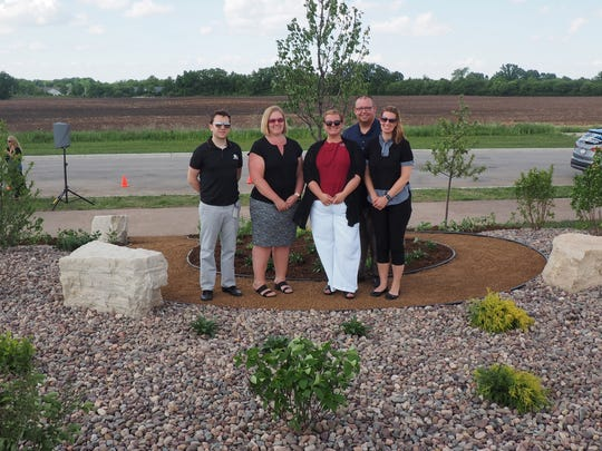 Leadership Fond du Lac Team Always Remembered stands Thursday in the new police memorial garden on Police Memorial Drive in Fond du Lac.