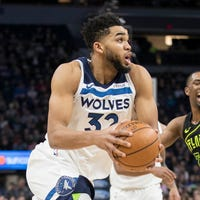 29e2f097a5eb Karl-Anthony Towns scores franchise-record 56 to lead T wolves by Hawks