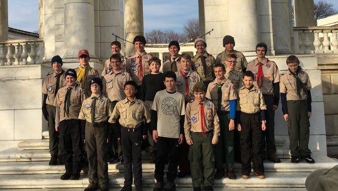 Boy Scouts from Troop 61 of Arden mark their visit to Arlington National Cemetery on Dec. 17, 2016, with a group photo at the Memorial Amphitheater.
