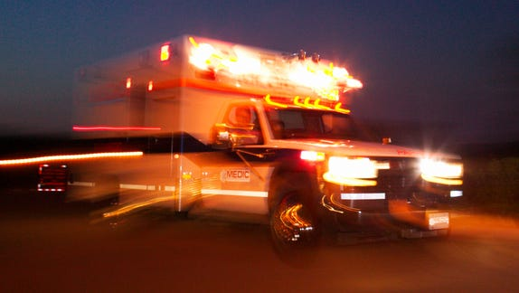 Motion blur of speeding ambulance.