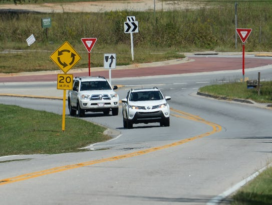 Cars drive through the roundabout on U.S.178 in Liberty