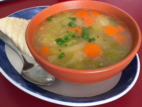 Albondiga (meatball) soup with a flour tortilla ($6).